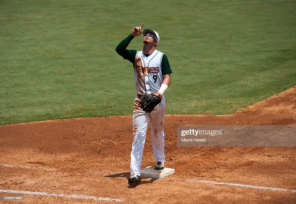 Miami Hurricanes outfielder Carl Chester celebrates after the second inning of Game 3 of the NCAA Super Regionals on Sunday June 12 at Mark Light...