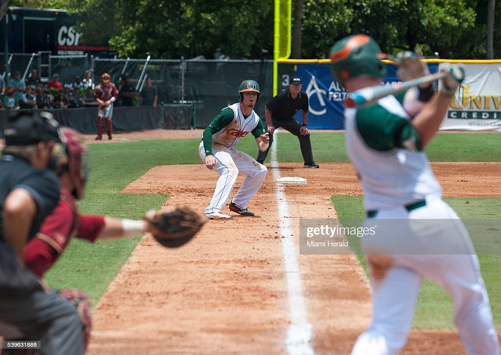 Miami Hurricanes outfielder Carl Chester waits to make his move to home during Game 3 of the NCAA Super Regionals on Sunday June 12 at Mark Light...
