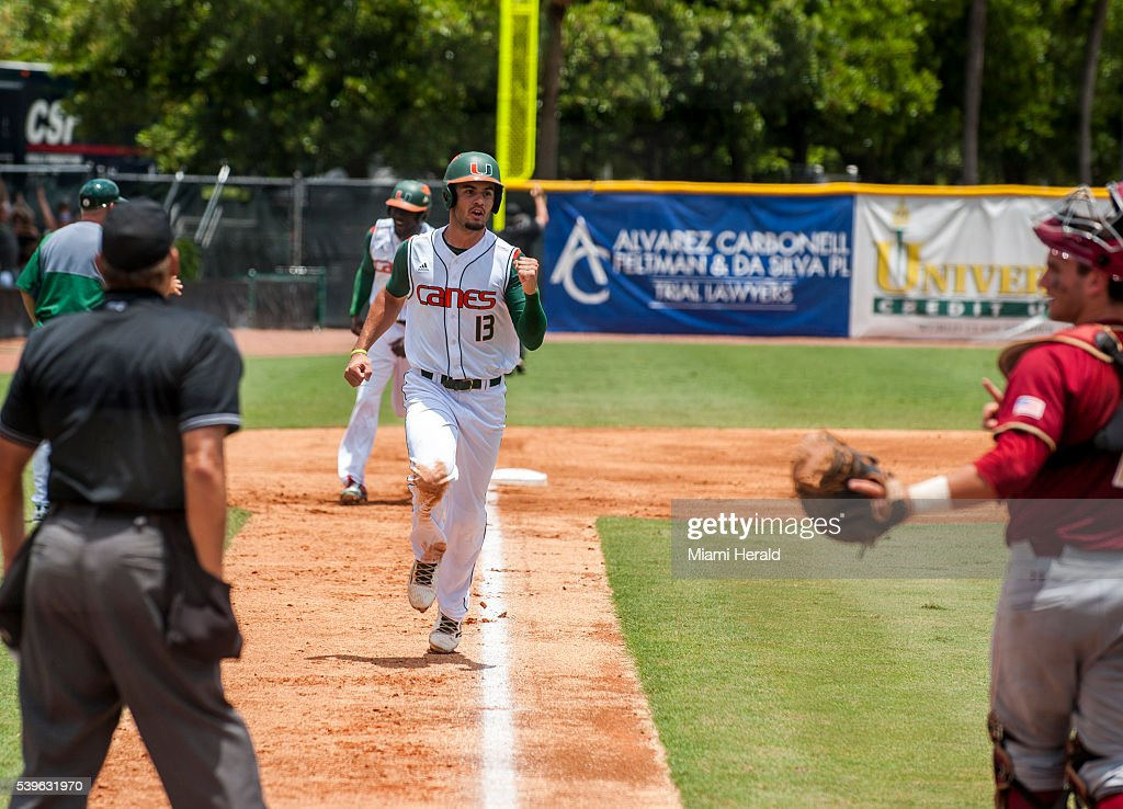 Miami Hurricanes outfielder Willie Abreu celebrates on his way to home plate after a threerun homer was hit during the second inning of Game 3 of the...