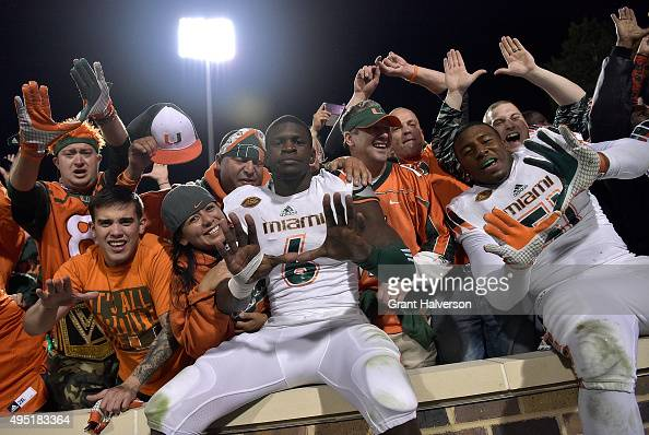 Miami Hurricanes players and fans celebrate after a win against the Duke Blue Devils at Wallace Wade Stadium on October 31 2015 in Durham North...