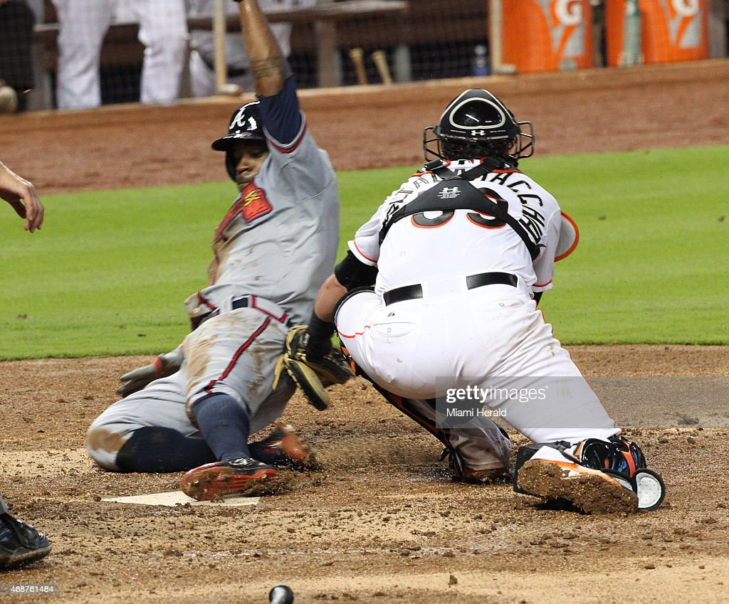 Miami Marlins Catcher Jarrod Saltalamacchia Tries To Tag Out Atlanta Braves Eric Young Jr