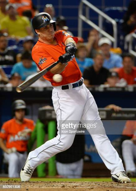 Miami Marlins catcher JT Realmuto at bat during a game between the Miami Marlins and the Colorado Rockies on August 13 2017 at Marlins Park Stadium...