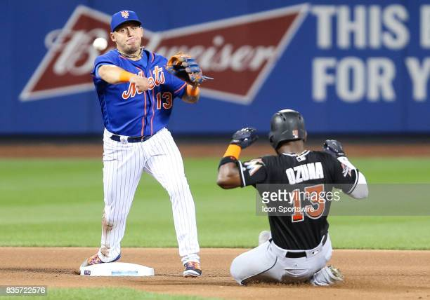 Miami Marlins Catcher JT Realmuto grounds into a double play Miami Marlins Left Fielder Marcell Ozuna out at second during the fourth inning of the...
