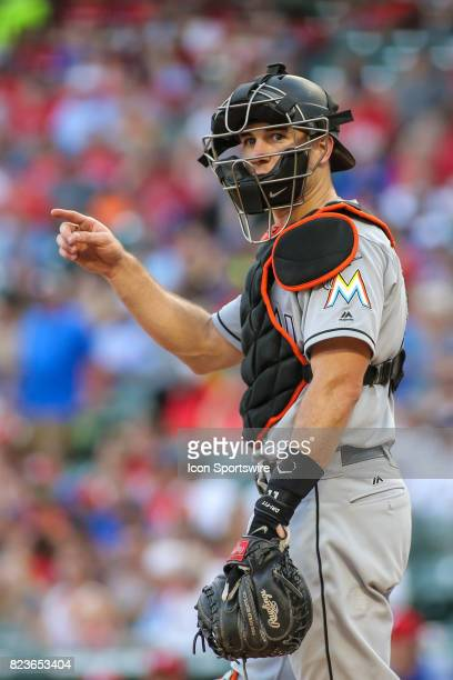 Miami Marlins catcher JT Realmuto looks to the bench for a formation call during the game between the Miami Marlins and the Texas Rangers on July 26...