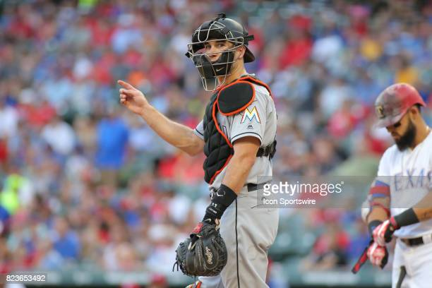 Miami Marlins catcher JT Realmuto looks to the bench for a formation during the game between the Miami Marlins and the Texas Rangers on July 26 at...
