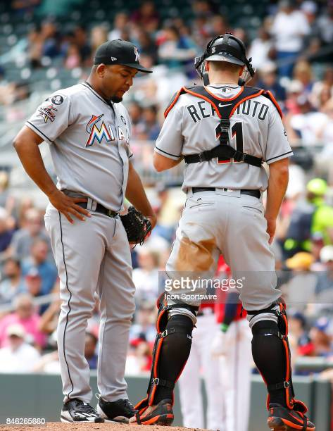 Miami Marlins catcher JT Realmuto meets with Miami Marlins pitcher Odrisamer Despaigne during the major league baseball game between the Atlanta...