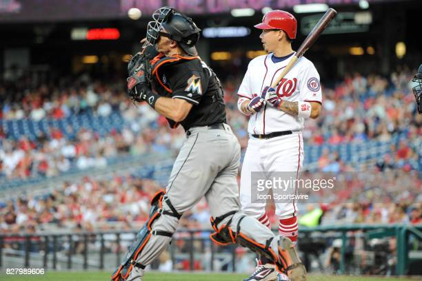 Miami Marlins catcher JT Realmuto throws to second base with Washington Nationals catcher Jose Lobaton at bat during an MLB game between the Miami...