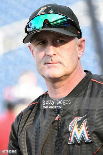 Miami Marlins catching coach Brian Schneider warms up prior to an MLB game between the Miami Marlins and the Washington Nationals on August 8 at...