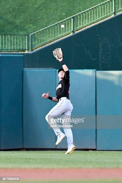 Miami Marlins center fielder Christian Yelich makes a leaping catch in the second inning during an MLB game between the Miami Marlins and the...