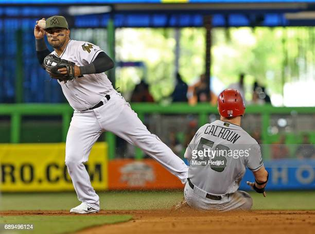 Miami Marlins' Christian Colon tags out the Los Angeles Angels' Cole Calhoun at second base in the fifth inning on Sunday May 28 2017 at Marlins Park...