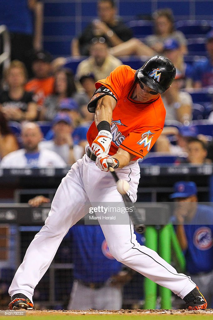 Miami Marlins' Derek Dietrich (32) singles on a soft fly ball during the eighth inning on Sunday, June 26, 2016, at Marlins Park in Miami.