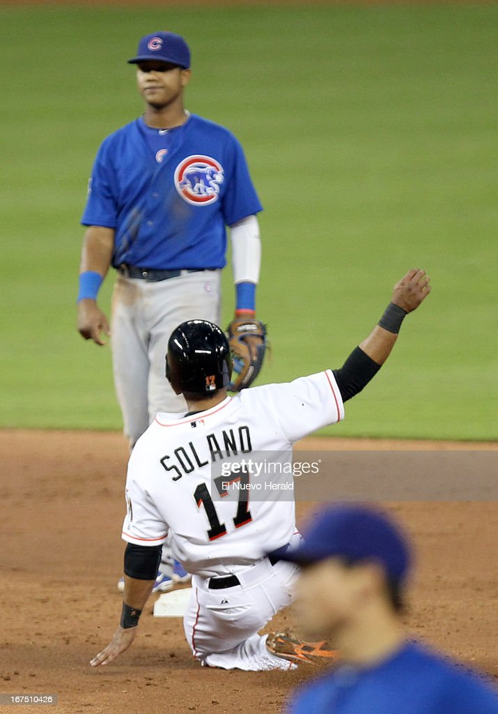 Miami Marlins' Donovan Solano lands safe on second base during second-inning action against the Chicago Cubs at Marlins in Miami, Florida, Thursday, April 25, 2013.