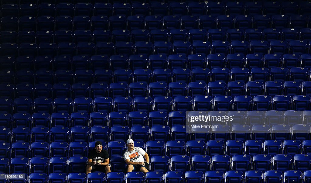 Miami Marlins fans watch during a game against the Atlanta Braves at Marlins Park on September 12, 2013 in Miami, Florida.