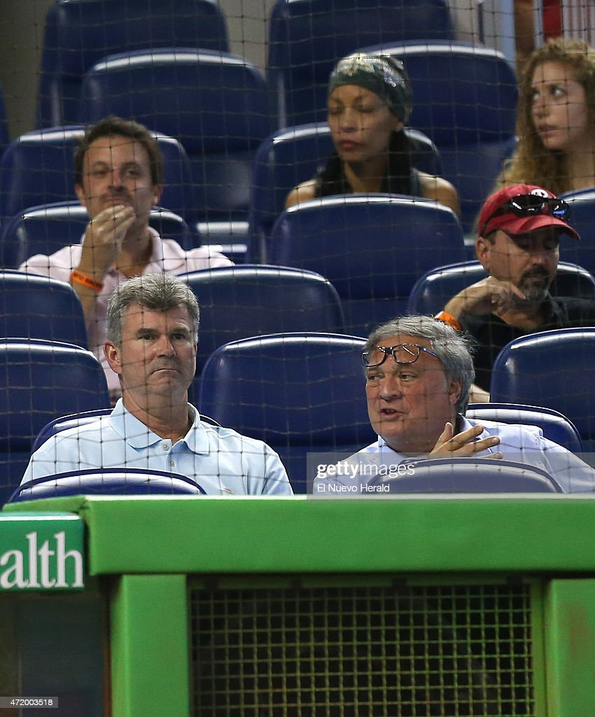 Miami Marlins general manager Dan Jennings left talks with Marlins owner Jeffrie Loria in the second inning of a game against the Philadelphia...