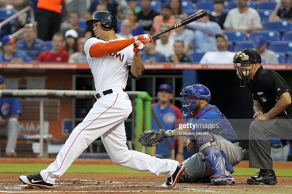 Miami Marlins' Giancarlo Stanton hits a single during first-inning action against the Chicago Cubs at Marlins in Miami, Florida, Thursday, April 25, 2013.