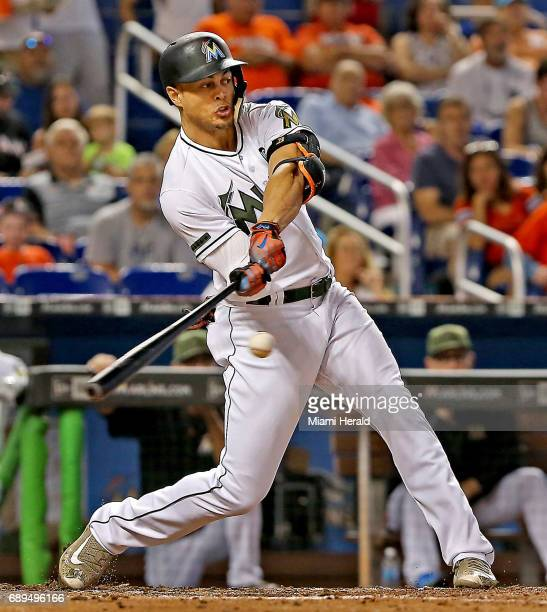 Miami Marlins' Giancarlo Stanton hits a single in the fourth inning against the Los Angeles Angels on Sunday May 28 2017 at Marlins Park in Miami Fla