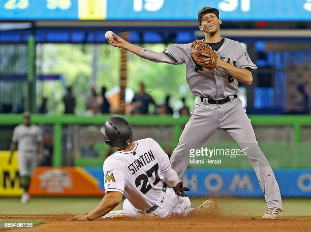 Miami Marlins' Giancarlo Stanton is out as he slides hard into second base under the tag of the Los Angeles Angels' Andrelton Simmons in the fourth...