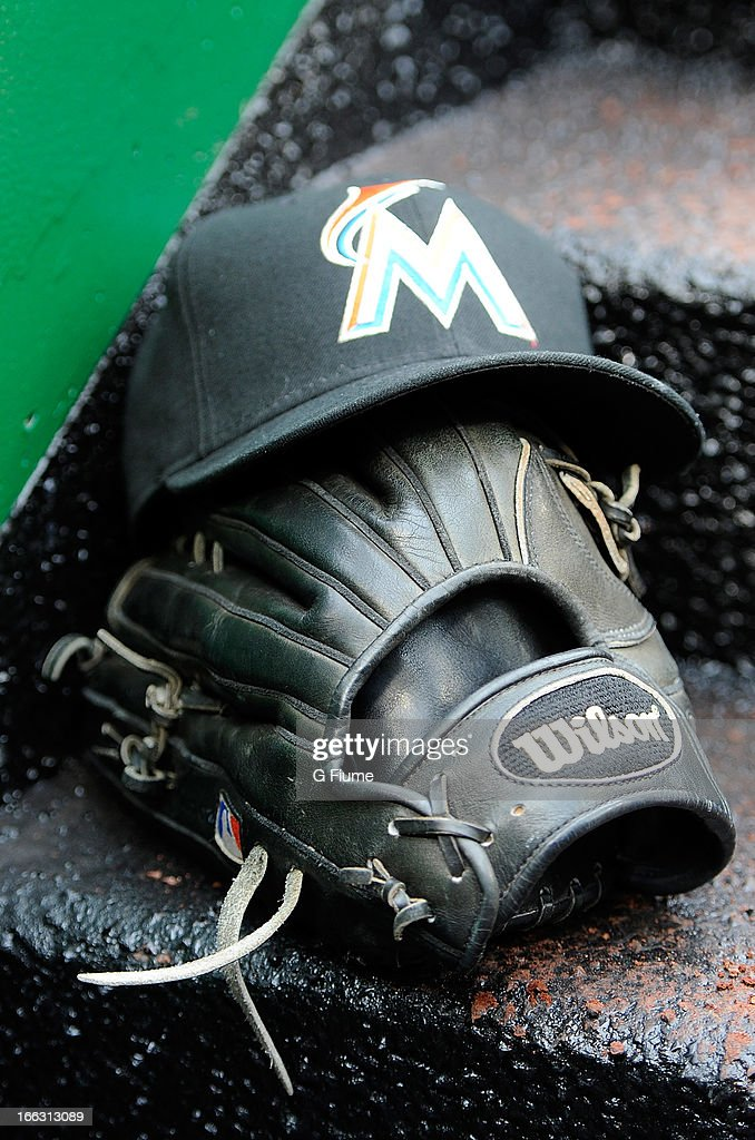 A Miami Marlins hat and baseball glove on the dugout stairs during the game against the Washington Nationals at Nationals Park on April 4, 2013 in Washington, DC.