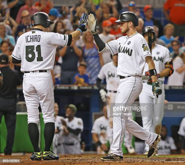 Miami Marlins' Ichiro Suzuki congratulates JT Riddle after his tworun homerun in the fifth inning against the Los Angeles Angels on Sunday May 28...