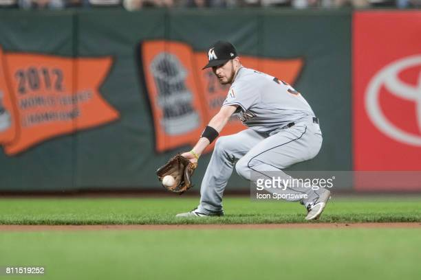 Miami Marlins Infield JT Riddle contorts to collect a grounder during the Major League Baseball game between the Miami Marlins and the San Francisco...