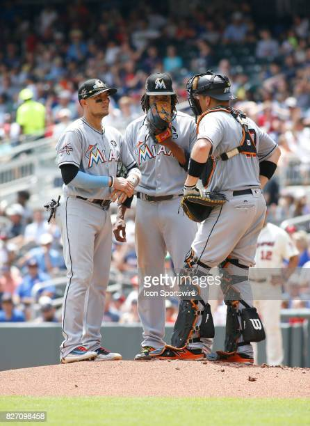 Miami Marlins infielder Miguel Rojas Miami Marlins starting pitcher Jose Urena and Miami Marlins catcher JT Realmuto have a meeting on the pitching...