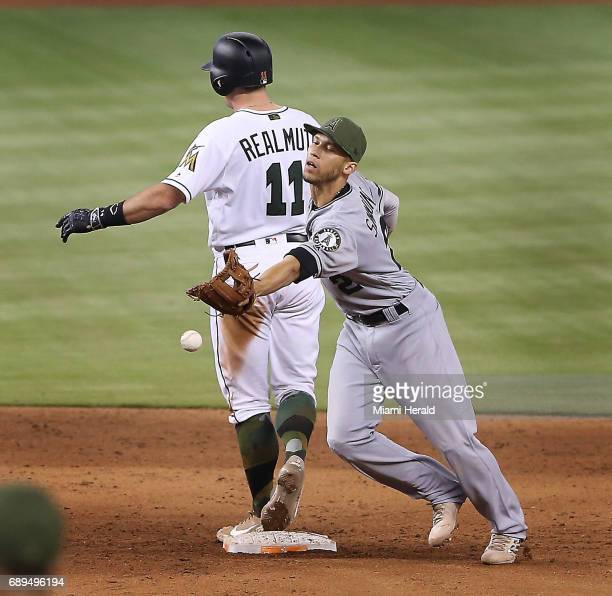 Miami Marlins' JT Realmuto slides safely into second base as the Los Angeles Angels' Andrelton Simmons fields the ball in the sixth inning on Sunday...