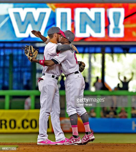 Miami Marlins JT Riddle and Dee Gordon embrace after the Miami Marlins beat the Atlanta Braves on Sunday May 14 2017 at Marlins Park in Miami Fla
