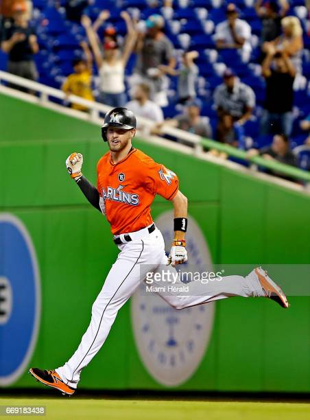 Miami Marlins' JT Riddle celebrates his walkoff homerun against the New York Mets on Sunday April 16 2017 at Marlins Park Stadium in Miami Fla