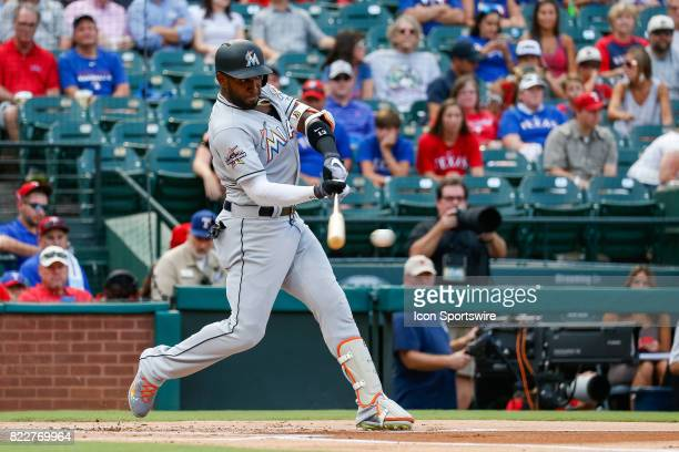 Miami Marlins Left field Marcell Ozuna bats during the MLB game between the Miami Marlins and Texas Rangers on July 24 2017 at Globe Life Park in...
