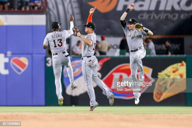 Miami Marlins Left field Marcell Ozuna celebrates with his teammates after winning the MLB game between the Miami Marlins and Texas Rangers on July...