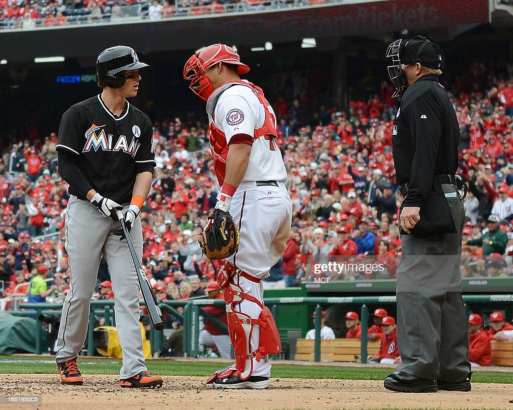 Miami Marlins left fielder Chris Coghlan (8), left, complains to home plate umpire Jeff Kellogg, right, about a called third strike against the Washington Nationals in the ninth inning at Nationals Park in Washington, D.C., Monday, April 1, 2013. The Nationals defeated the Marlins, 2-0.