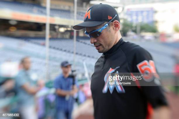 Miami Marlins left fielder Ichiro Suzuki walks to the dugout following batting practice prior to an MLB game between the Miami Marlins and the...