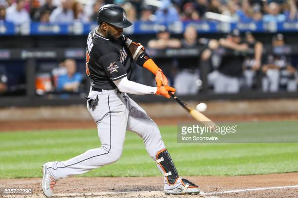 Miami Marlins Left Fielder Marcell Ozuna singles during the fourth inning of the Major League Baseball game between the Miami Marlins and the New...