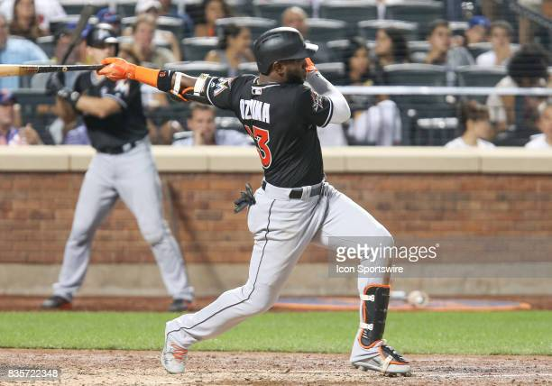Miami Marlins Left Fielder Marcell Ozuna singles scoring Miami Marlins Second Baseman Dee Gordon to break up the scoreless tie during the sixth...