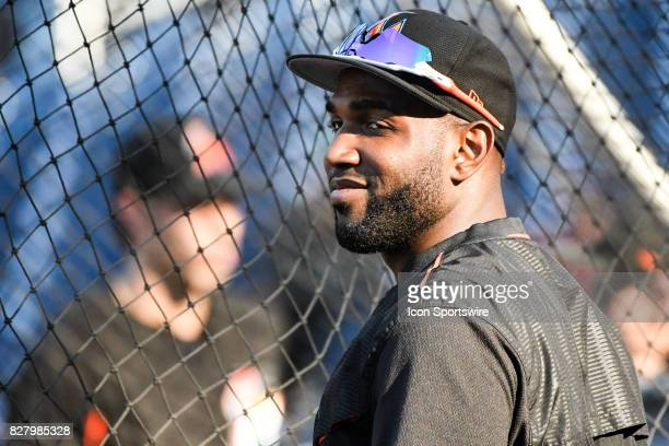 Miami Marlins left fielder Marcell Ozuna takes batting practice during an MLB game between the Miami Marlins and the Washington Nationals on August 8...
