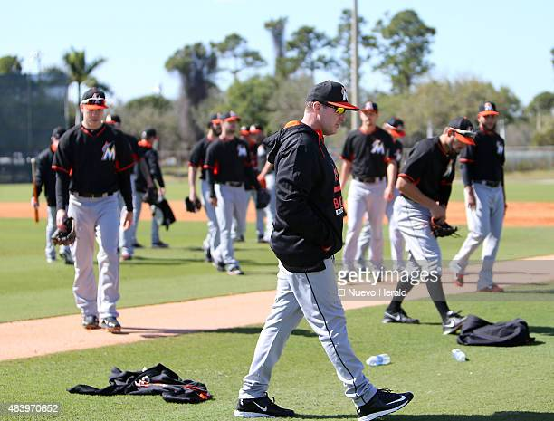 Miami Marlins manager Mike Redmond center walks during the spring training baseball workouts for pitchers and catchers at Roger Dean Stadium on...