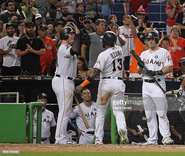 Miami Marlins' Marcell Ozuna center gets a highfive from teammate Justin Bour left The Miami Marlins played its last game of the season against the...
