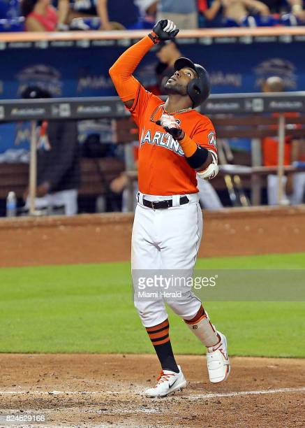 Miami Marlins' Marcell Ozuna crosses homeplate after hitting a threerun homerun in the ninth inning against the Cincinnati Reds on Sunday July 30...