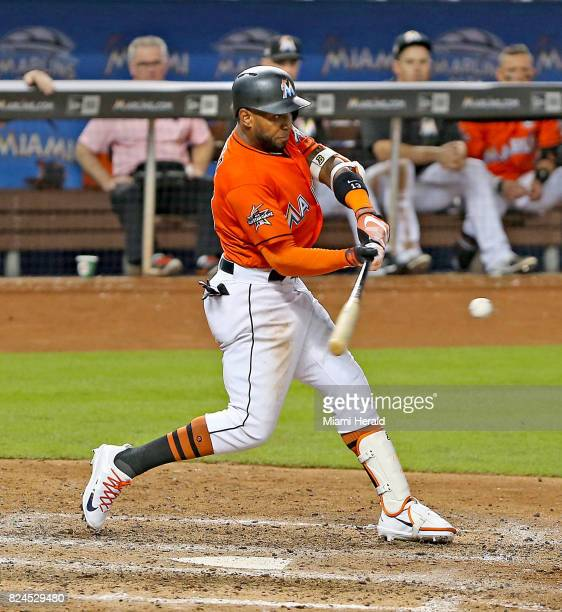 Miami Marlins' Marcell Ozuna hits a threerun home run in the ninth inning against the Cincinnati Reds on Sunday July 30 2017 in Miami Fla