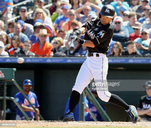 Miami Marlins outfielder Ichiro Suzuki singles during the fifth inning of a spring training game against the New York Mets in Jupiter Florida on...
