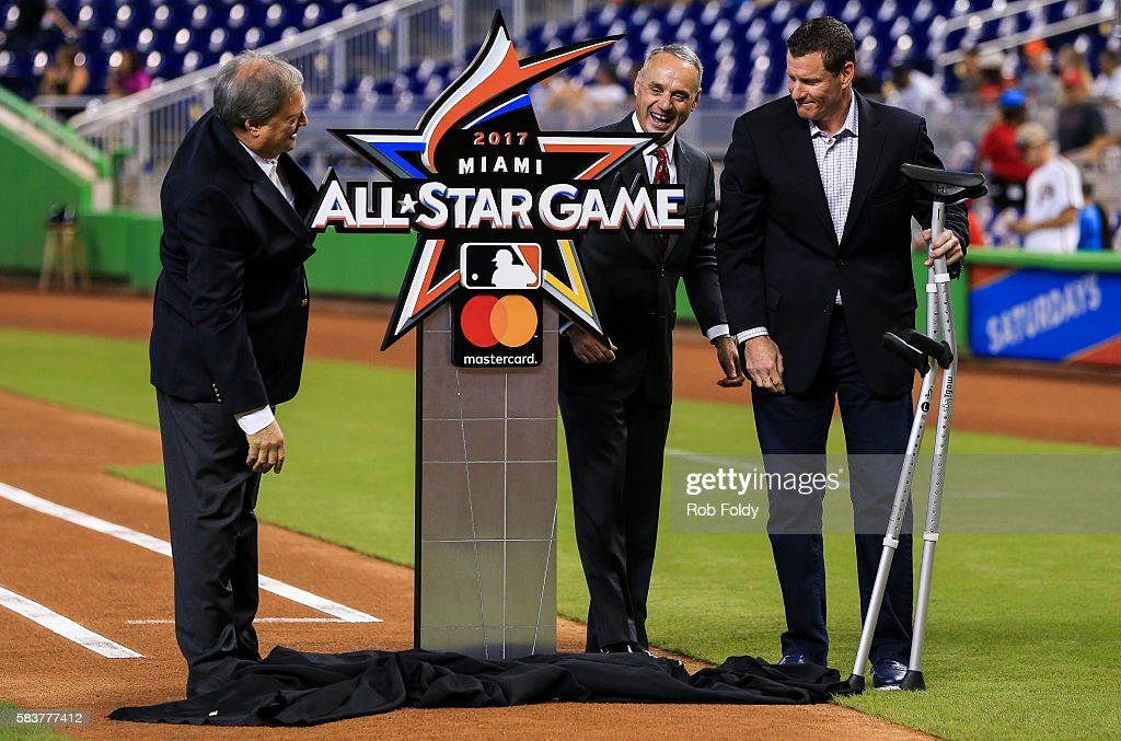 Miami Marlins owner Jeffrey Loria, Major League Baseball commissioner Rob Manfred and former Marlin Jeff Conine looks on for the unveiling of the 2017 All-Star Game logo before the game between the Miami Marlins and the Philadelphia Phillies at Marlins Park on July 27, 2016 in Miami, Florida.