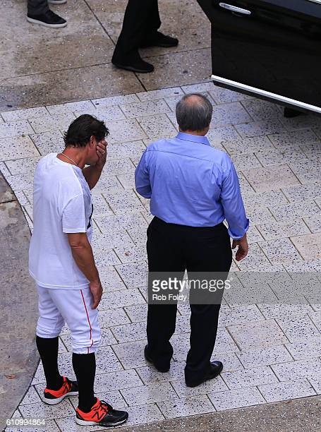 Miami Marlins owner Jeffrey Loria right and manager Don Mattingly left await the late Jose Fernandez' mother Maritza Fernandez as Miami Marlins...