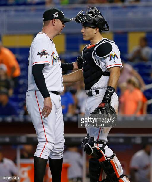 Miami Marlins pitcher Brad Ziegler left celebrates with catcher JT Realmuto after an 81 win against the San Francisco Giants at Marlins Park in Miami...