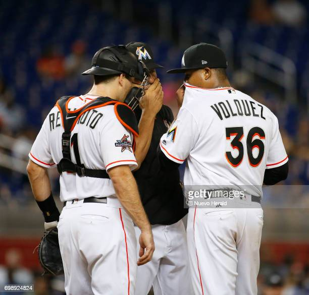 Miami Marlins pitcher Edinson Volquez talks with catcher JT Realmuto and pitching coach Juan Nieves after the Washington Nationals score during the...