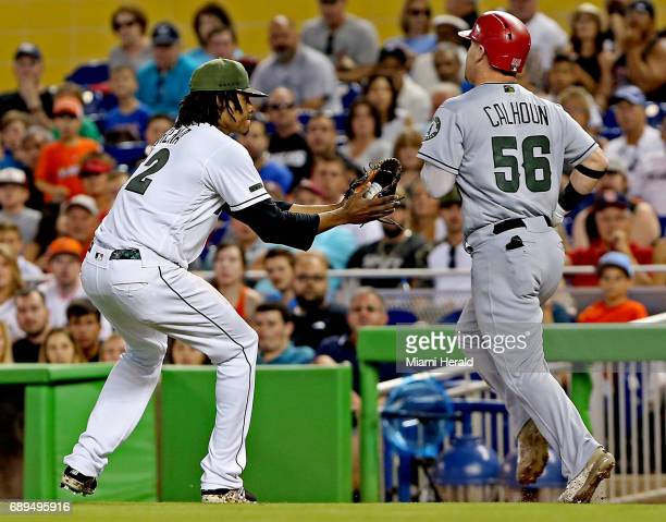 Miami Marlins pitcher Jose Urena tags out the Los Angeles Angels' Kole Calhoun as he runs to first base in the second inning on Sunday May 28 2017 at...