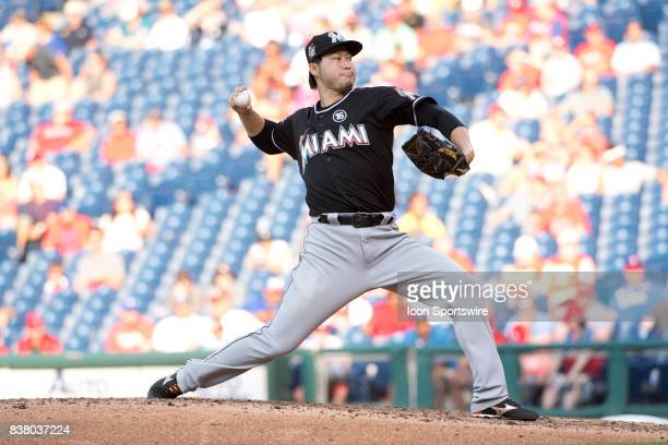 Miami Marlins Pitcher Junichi Tazawa winds up in the seventh inning during the game between the Miami Marlins and Philadelphia Phillies on August 22...