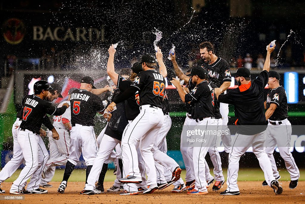 Miami Marlins players celebrate after Jeff Baker hits a walkoff RBI to end the game against the Washington Nationals in the ninth inning at Marlins...