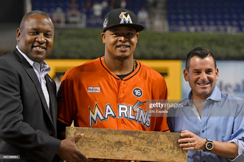 Miami Marlins President of Baseball Operations Michael Hill and President David Samson present Edinson Volquez #36 with the pitching rubber from his no hitter before the start of the game against the Arizona Diamondbacks at Marlins Park on June 4, 2017 in Miami, Florida.