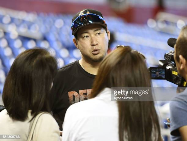 Miami Marlins reliever Junichi Tazawa speaks to reporters in Miami Florida on May 17 after the club said he has been placed on the 10day disabled...