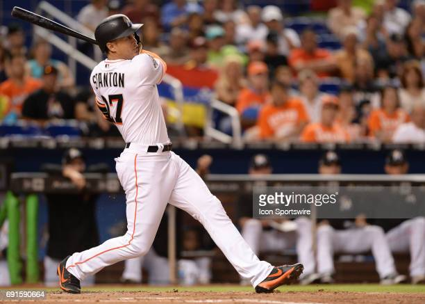 Miami Marlins right fielder Giancarlo Stanton follows the ball going going gone another Stanton home run during a game between the Miami Marlins and...